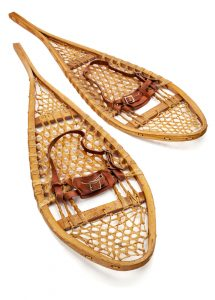 Vintage wooden Huron snowshoes with leather binding