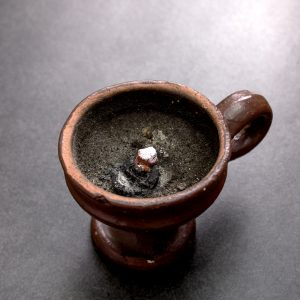 Old censer on table, close up photo